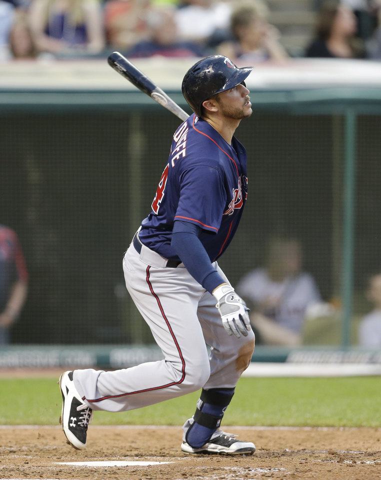 Minnesota Twins' Trevor Plouffe hits a double off Cleveland Indians starting pitcher Scott Kazmir in the seventh inning of a baseball game on Friday, June 21, 2013, in Cleveland. (AP Photo/Tony Dejak)