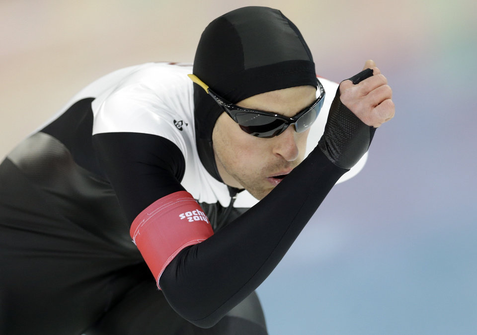Photo - Canada's Denny Morrison competes in the men's 1,500-meter speedskating at the Adler Arena Skating Center during the 2014 Winter Olympics in Sochi, Russia, Saturday, Feb. 15, 2014. (AP Photo/Patrick Semansky)