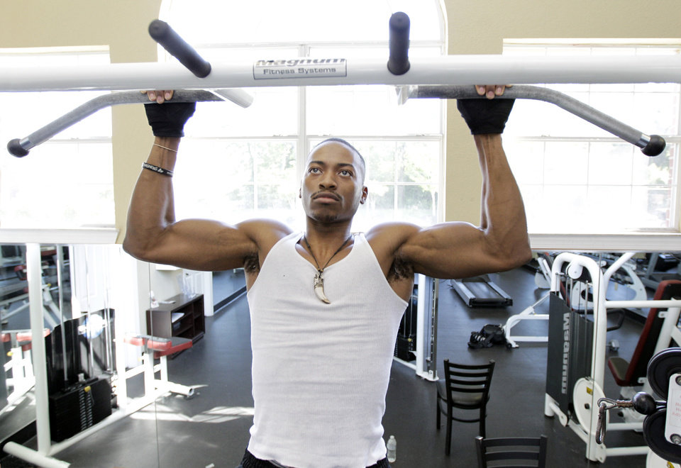 Photo -   In this photo taken Thursday, April 19, 2012, Kelman Edwards Jr., working out at an apartment complex gym near the campus of Middle Tennessee State University in Murfreesboro,Tenn. The college class of 2012 is in for a rude welcome to the world of work. A weak labor market already has left half of young college grads either jobless or underemployed in positions that don't fully use their skills and knowledge. (AP Photo/Mark Humphrey)