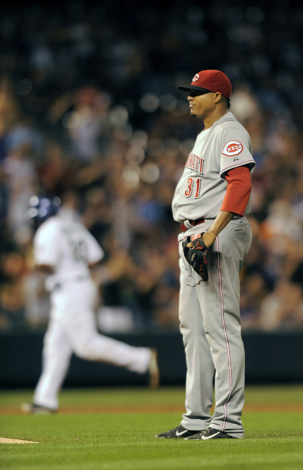Photo - Cincinnati Reds starting pitcher Alfredo Simon stands on the mound after giving up a three-run home run to Colorado Rockies Charlie Culberson in the fifth inning of a baseball game on Thursday, Aug. 14, 2014, in Denver. (AP Photo/Chris Schneider)