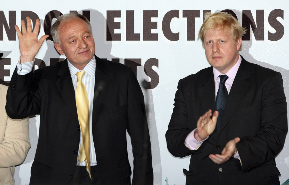 Photo -   FILE - In this May 3, 2008 file photo, outgoing mayor of London, the Labour Party candidate Ken Livingstone, left, waves after being defeated in the London mayoral elections by Conservative Party candidate Boris Johnson, right, as the results are announced at City Hall in London. Analysts say it's an Olympic tussle, an election battle to win control of London's City Hall just weeks before thousands of athletes and spectators arrive in Britain's capital for the Summer Games. But local elections being held Thursday May 3, 2012 across Britain, including a vote for London's mayor, could have more far reaching repercussions _ catapulting Boris Johnson, the capital's famously outspoken, but well liked leader, on a path to national power. (AP Photo/Matt Dunham, File)