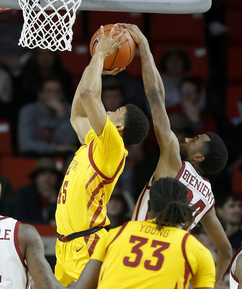 Photo - Oklahoma's Jamal Bieniemy (24) blocks the shot of Iowa State's Rasir Bolton (45) during an NCAA basketball game between the University of Oklahoma Sooners (OU) and the Iowa State Cyclones at the Lloyd Noble Center in Norman, Okla., Wednesday, Feb. 12, 2020. [Bryan Terry/The Oklahoman]