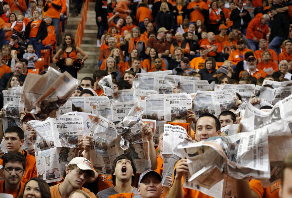 Photo - Students cheer before the Bedlam men's college basketball game between the Oklahoma State University Cowboys and the University of Oklahoma Sooners at Gallagher-Iba Arena in Stillwater, Okla., Saturday, Feb. 16, 2013. Photo by Sarah Phipps, The Oklahoman