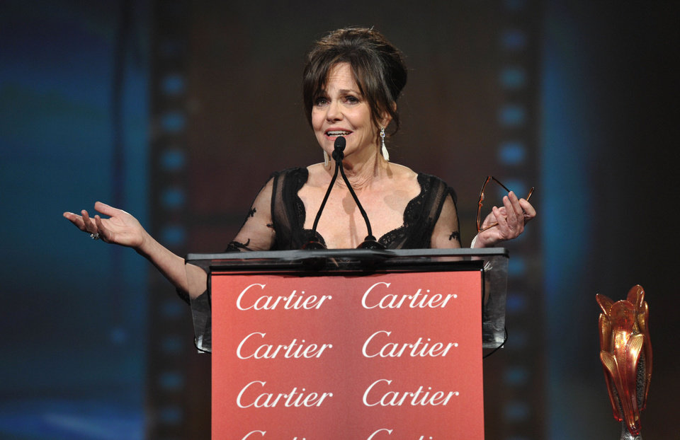 Photo - Sally Field appears on stage at the 24th Annual Palm Springs International Film Festival Awards Gala on Saturday, Jan. 5, 2013 in Palm Springs, Calif. The gala honors individuals in the film industry with awards for acting, directing, achievement in film scoring and lifetime achievement. (Photo by John Shearer/Invision/AP Images)