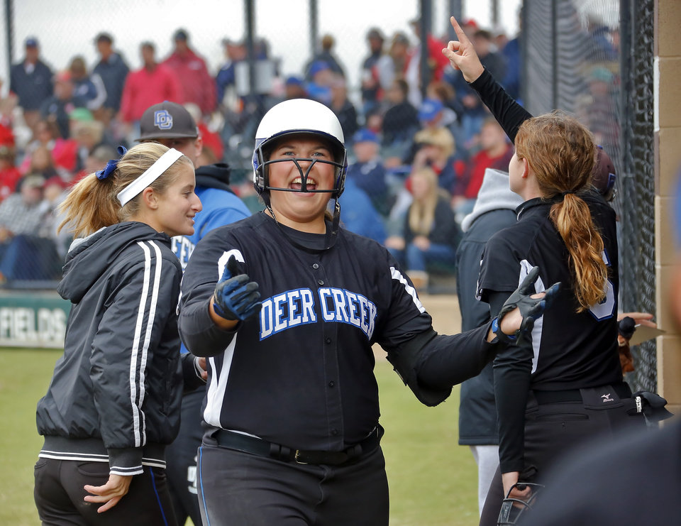 Deer Creek's Emily Watson celebrates after hitting a two run home run during the Class 5A state semi final game between Deer Creek and Claremore at the Ballfields at Firelake in Shawnee, Okla. on, Friday, Oct. 18, 2013.  Photo by Chris Landsberger, The Oklahoman