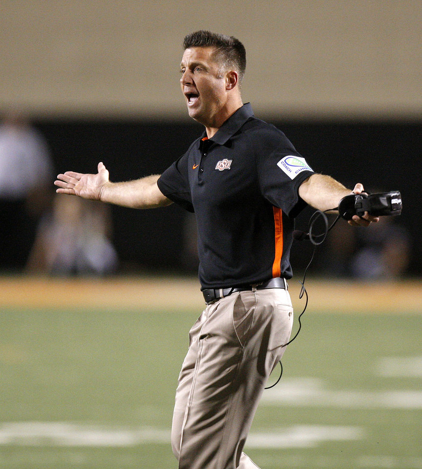Photo - Oklahoma State coach Mike Gundy reacts during a college football game between Oklahoma State University (OSU) and the University of Texas (UT) at Boone Pickens Stadium in Stillwater, Okla., Saturday, Sept. 29, 2012. Oklahoma State lost 41-36. Photo by Bryan Terry, The Oklahoman