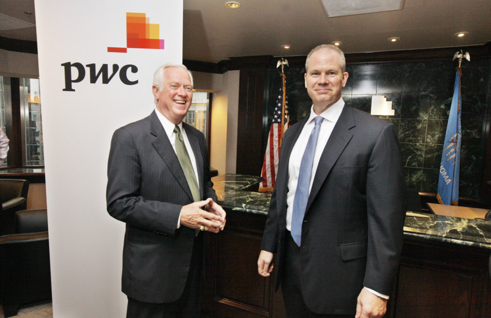 Photo -  Roy Williams, Greater Oklahoma City Chamber president, and Gregg Cheshier, managing partner for the new Oklahoma City PcW location, talk in the lobby of the office.    PAUL B. SOUTHERLAND -