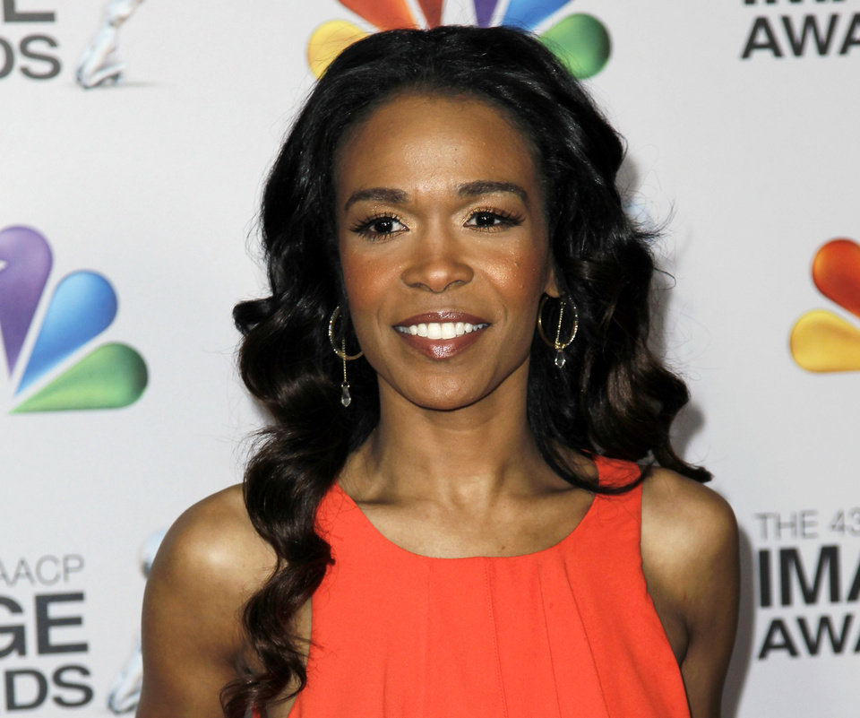 FILE - This Feb. 17, 2012 file photo shows singer-actress Michelle Williams at the 43rd NAACP Image Awards in Los Angeles. Williams is joining the latest national tour of the musical �Fela!� Producers said Thursday, Jan. 3, 2013, the singer who starred on the UPN sitcom �Half & Half� will be onstage when the tour opens at Sidney Harman Hall in Washington, D.C., on Jan. 29.  Williams, part of Destiny's Child along with Kelly Rowland and Beyonce, is now solo artist who released the dance album �Unexpected� and the single �On The Run.� (AP Photo/Matt Sayles, file)