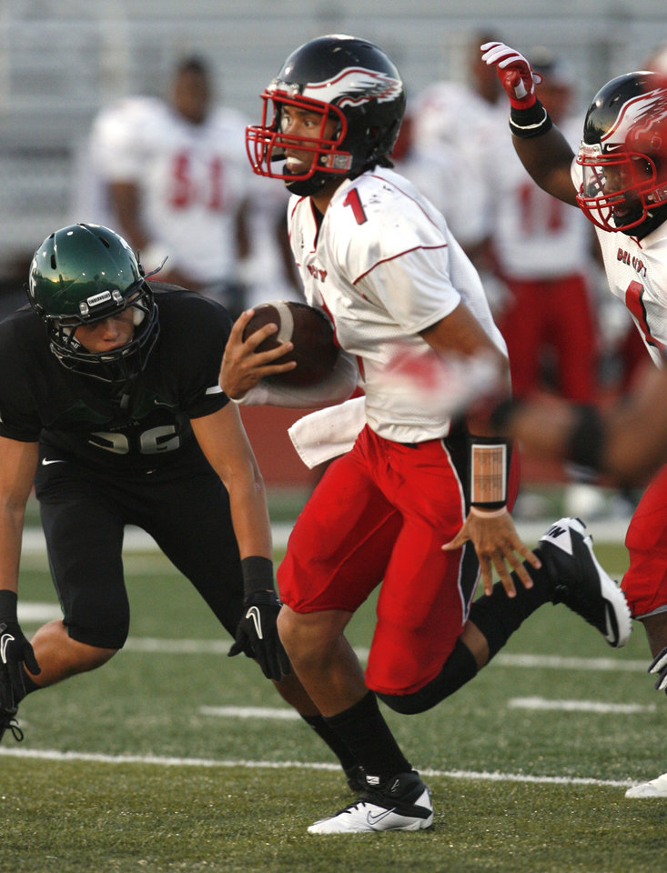 Photo - Del City quarterback Chazten Gonzales makes a long run in the first quarter against Norman North in high school football at Harve Collins Field on Thursday, Sept. 9, 2010, in Norman, Okla.  Photo by Steve Sisney, The Oklahoman