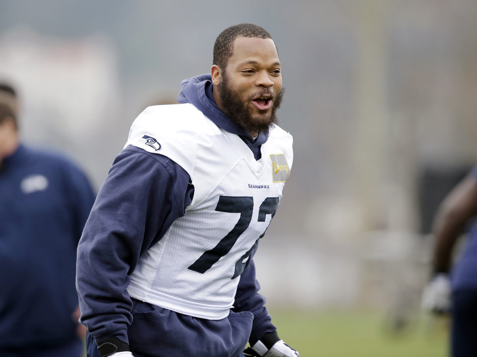 Photo - Seattle Seahawks' Michael Bennett yells at an NFL football practice Thursday, Jan. 16, 2014, in Renton, Wash. The Seahawks are to play the San Francisco 49ers on Sunday in the NFC championship game. (AP Photo/Elaine Thompson)