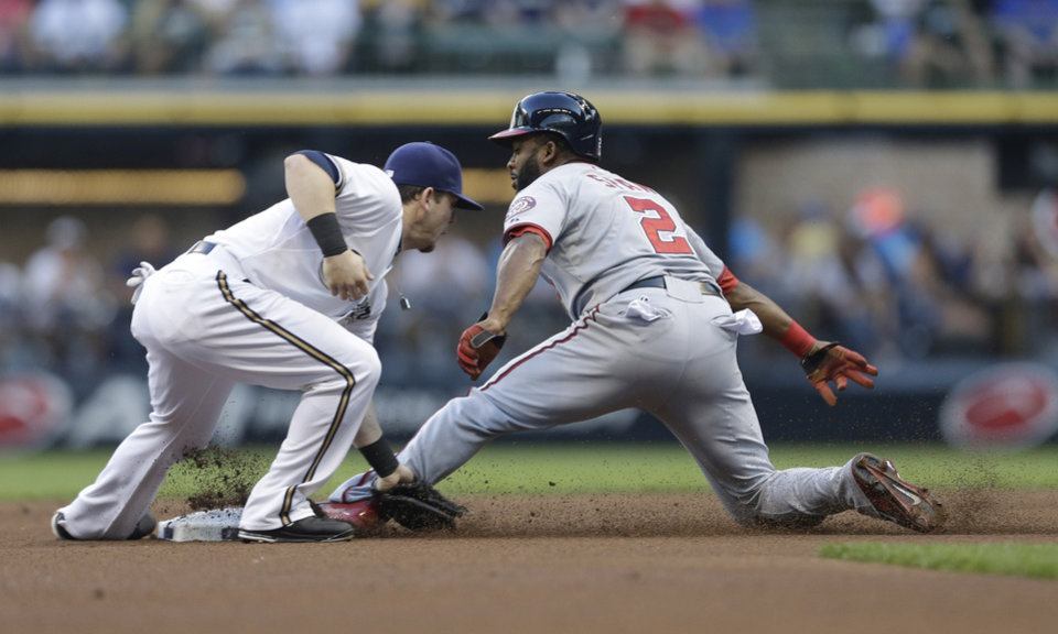 Photo - Washington Nationals' Denard Span (2) steals second base ahead of the tag by Milwaukee Brewers' Scooter Gennett during the first inning of a baseball game Tuesday, June 24, 2014, in Milwaukee. (AP Photo/Jeffrey Phelps)