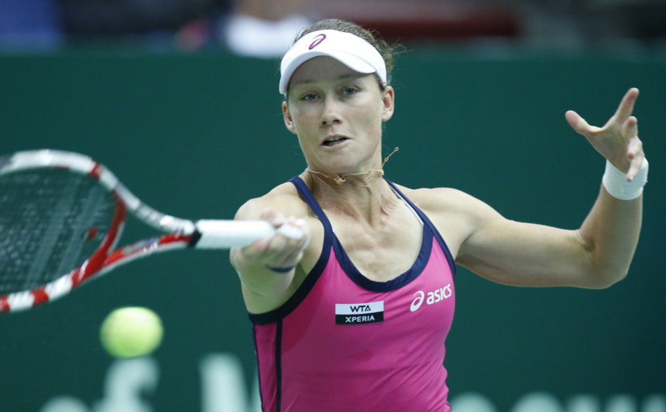 Photo -   Australia's Samantha Stosur returns a ball to Serbia's Ana Ivanovic during a semifinal match at the Kremlin Cup tennis tournament in Moscow, Russia, Saturday, Oct. 20, 2012. (AP Photo/Misha Japaridze)