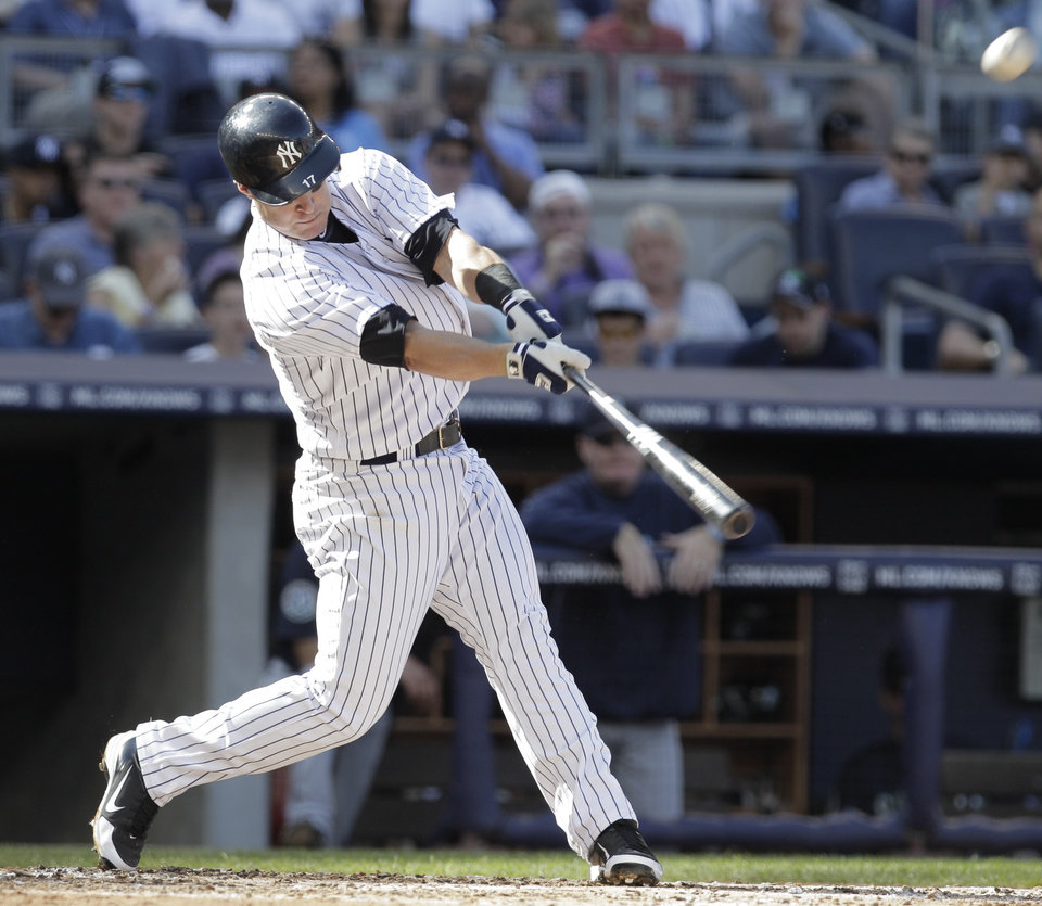 Photo -   New York Yankees Jayson Nix hits a two-run home run in the second inning of a baseball game against the Seattle Mariners on Saturday, May 12, 2012 in New York. (AP Photo/Peter Morgan)