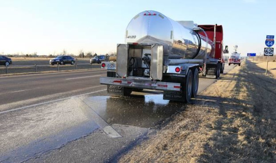 Photo - A tanker truck parked on the side of southbound I-44 just south of SW 89 Street in Oklahoma City Wednesday, Feb. 26, 2014. The tanker started leaking its load of syrup on I-44 in NW Oklahoma City leaving the right lane slick from NW 39 Street to SW 89. Photo by Paul B. Southerland, The Oklahoman