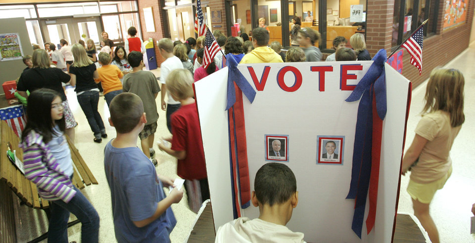 Photo - Truman elem. students take park in a mock election Tuesday, Nov. 4th 2008. BY JACONNA AGUIRRE, THE OKLAHOMAN.