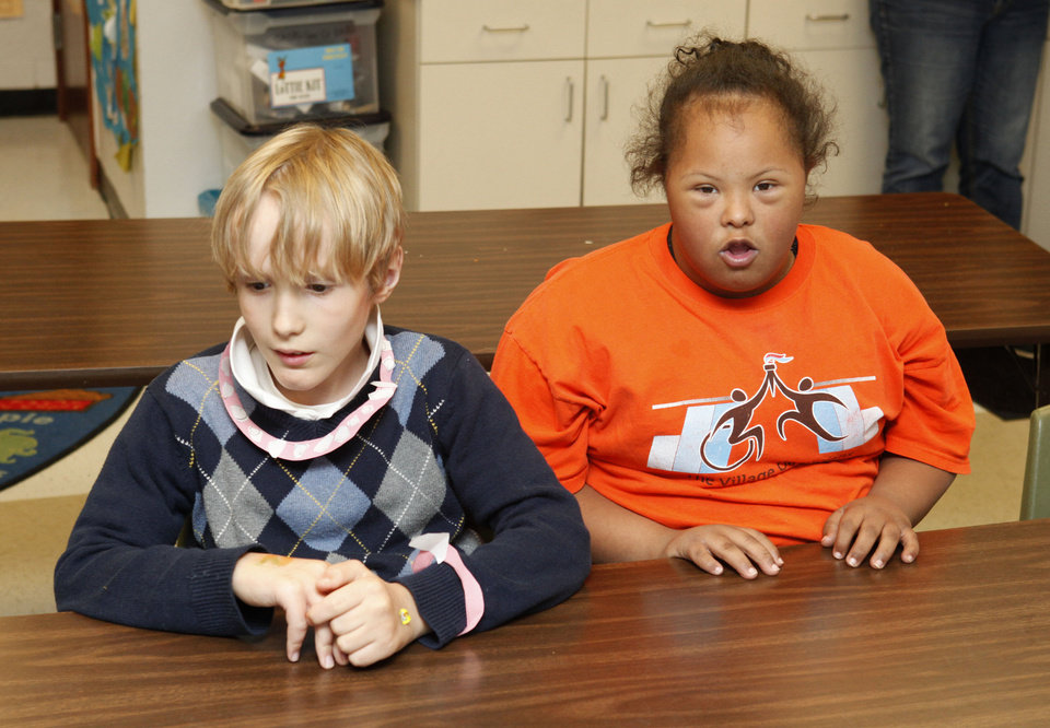 Photo - Special needs students William Hefner and Wendy Viney listen to instructor Angie Absher Thursday at Johnson Elementary School. Photo by Paul Hellstern, The Oklahoman  PAUL HELLSTERN