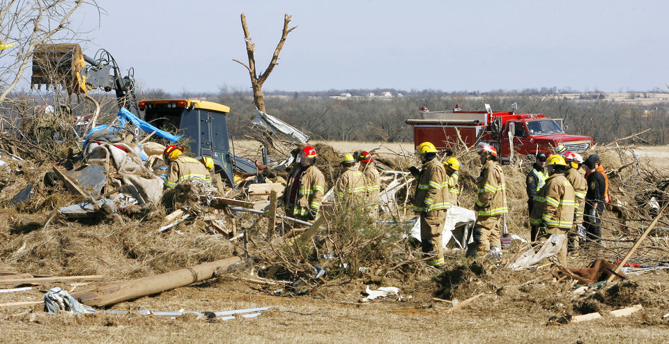 Firemen looking through mobile home debris for unaccounted persons on Brock Road in Lone Grove, Wednesday, Feb. 11, 2009. BY PAUL B. SOUTHERLAND, THE OKLAHOMAN