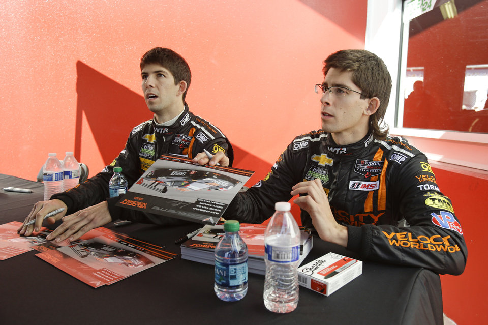 Photo - Drivers Ricky Taylor, left, and Jordan Taylor talk with fans during an autograph session prior to the start of the IMSA Series Rolex 24 hour auto race at Daytona International Speedway in Daytona Beach, Fla., Saturday, Jan. 25, 2014.(AP Photo/John Raoux)