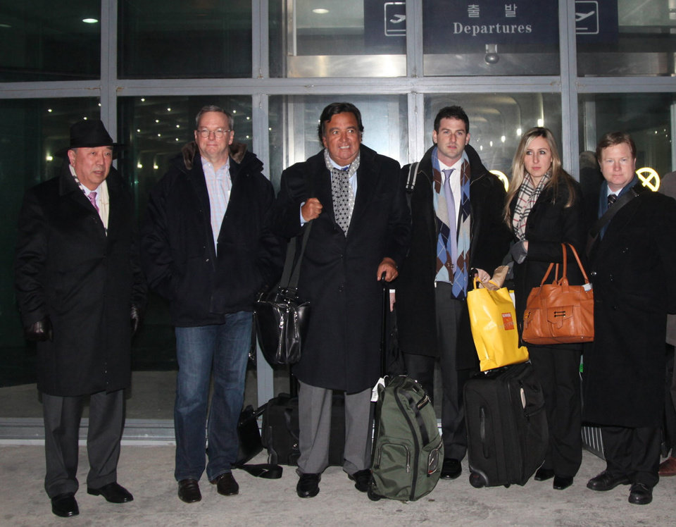 Photo - In this photo provided by China's Xinhua News Agency, former New Mexico Gov. Bill Richardson, third left, and Google Executive Chairman Eric Schmidt, second left, pose for photos after arriving at an airport in Pyongyang, North Korea, Monday,  Jan. 7, 2013. The Google chairman wants a first-hand look at North Korea's economy and social media in his private visit Monday to the communist nation, his delegation said, despite misgivings in Washington over the timing of the trip.  (AP Photo/Xinhua, Zhang Li) NO SALES