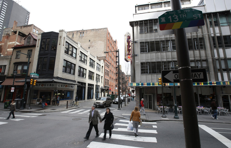 Photo - In this Tuesday, April 1, 2014 photo, pedestrians cross 13th Street near El Vez, a gregarious Mexican restaurant, and Capogiro gelato in Philadelphia. Tourism officials will tell you the restaurant-rich area in the heart of downtown is called Midtown Village, but that moniker hasn't entirely caught on with locals. Philadelphia food lovers just know 13th Street as a vibrant area chock full of great eateries and wine bars. (AP Photo/Matt Slocum)
