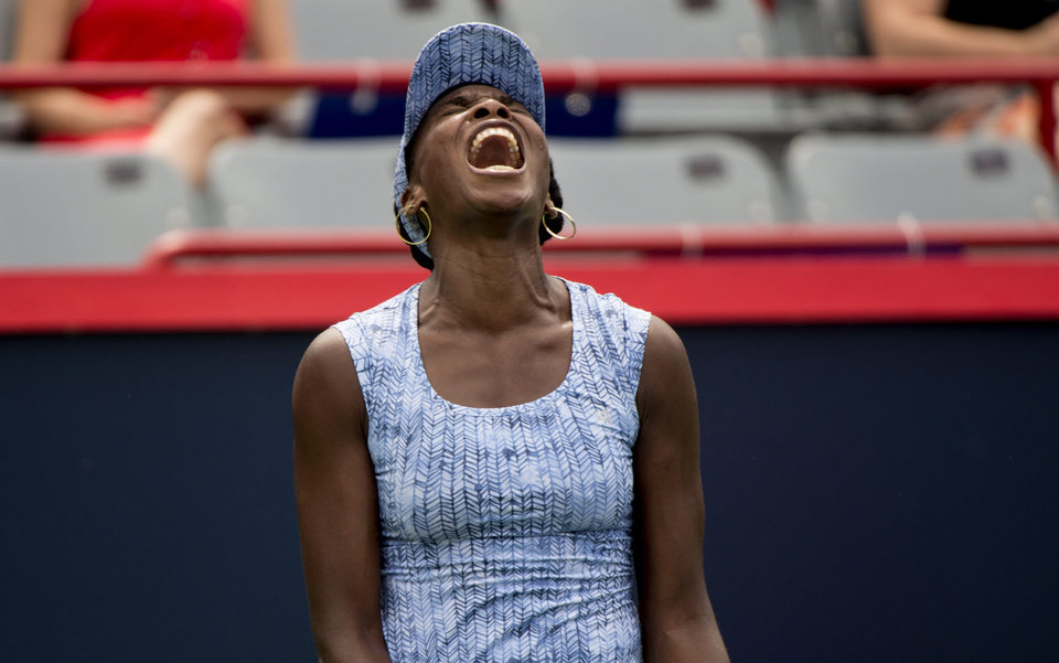 Photo - Venus Williams reacts after losing the fourth game in the second set to Anastasia Pavlyuchenkova, of Russia, during her first round match at the Rogers Cup tennis tournament in Montreal on Tuesday, Aug. 5, 2014. (AP Photo/The Canadian Press, Paul Chiasson)