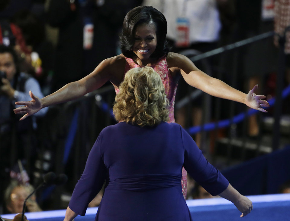 Photo - First Lady Michelle Obama hugs Elaine Brye before speaking at the Democratic National Convention in Charlotte, N.C., on Tuesday, Sept. 4, 2012. (AP Photo/Lynne Sladky)  ORG XMIT: DNC518