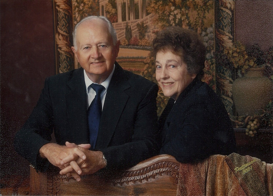 Photo - Far left:   Bob and Barbara Pettis pose for their  50th anniversary portrait.
