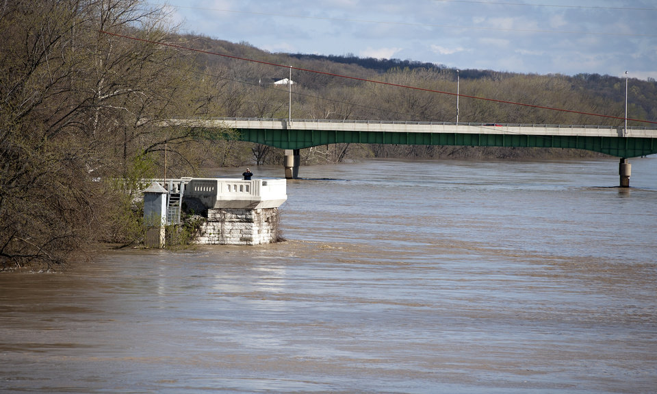 Photo - A person observes the flooding on the Wabash River from the Brown Street Overlook, in West Lafayette, Ind. on Saturday, April 20, 2013. (AP Photo/The Journal & Courier, Brent Drinkut) MANDATORY CREDIT; NO SALES