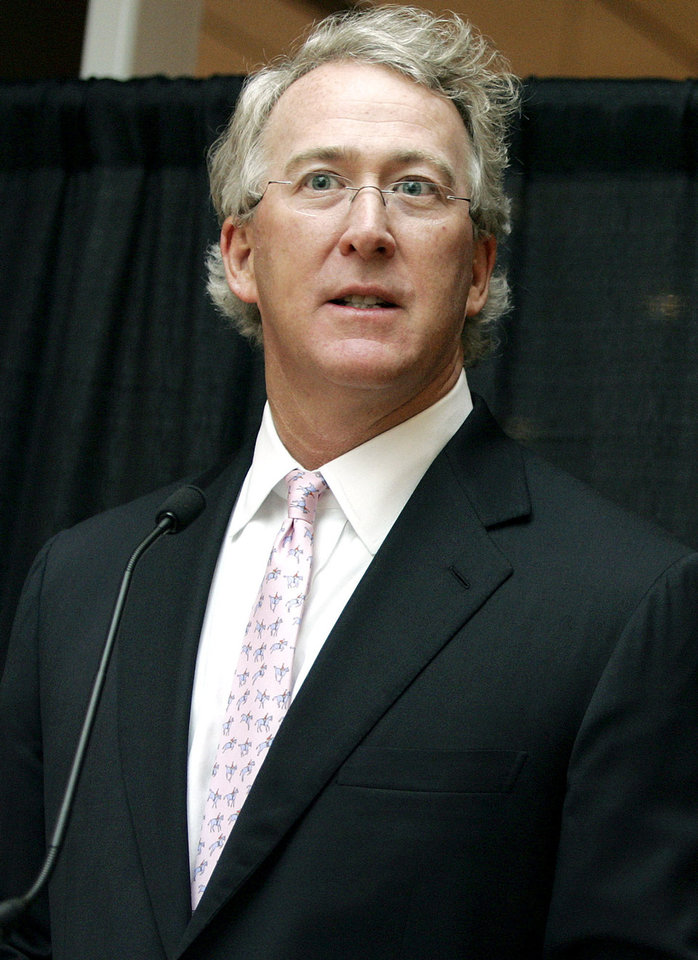 Photo - Aubrey McClendon, chairman, chief executive (CEO), and co-founder of Chesapeake Energy, speaks during a reception at Chesapeake Energy's Oklahoma City campus on Monday, March 26, 2007. Chesapeake Energy is donating $1.1 million in scholarships to the university's business college. By John Clanton, The Oklahoman ORG XMIT: KOD