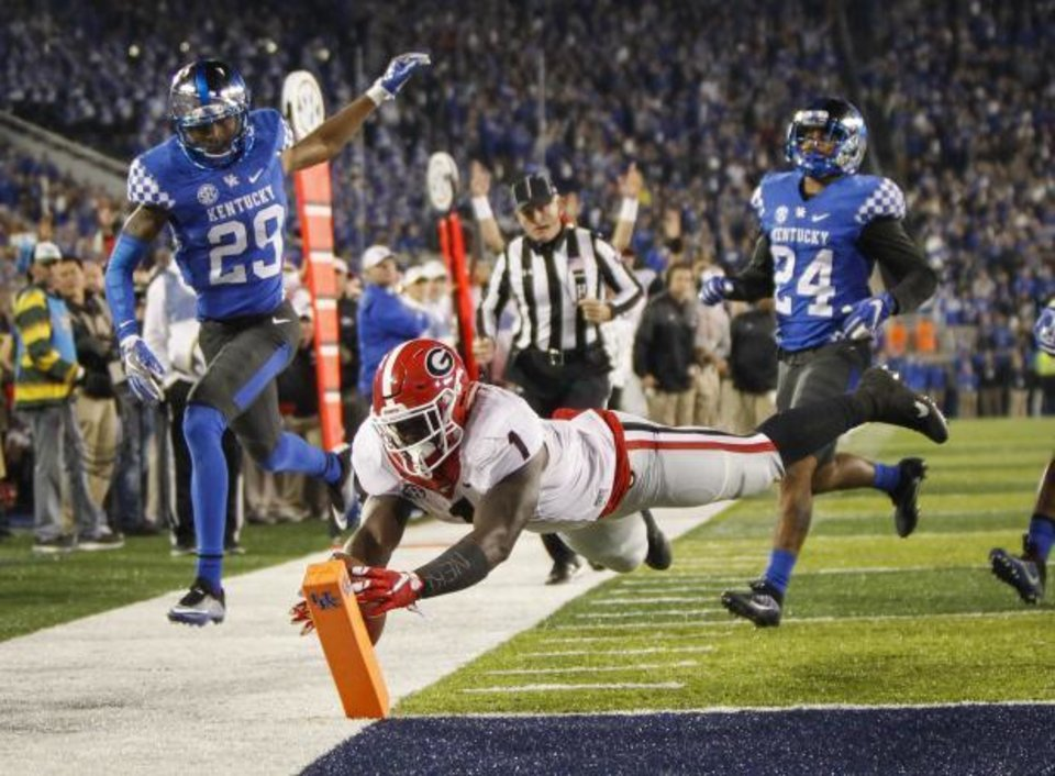 Photo - Georgia tailback Sony Michel dives for a touchdown last week against Kentucky. (AP Photo)