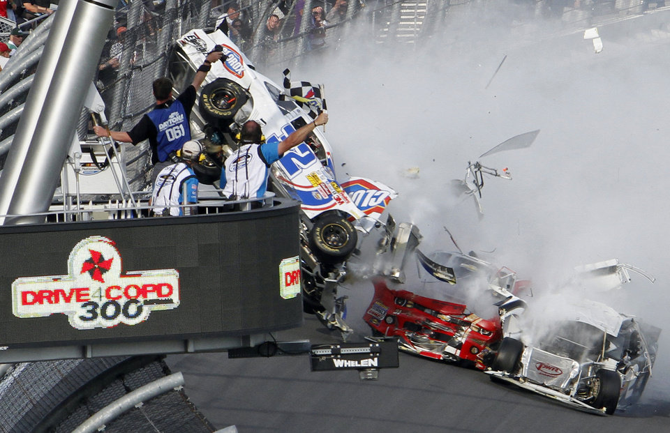 Kyle Larson\'s car (32) gets airborne during a multi-car wreck on the final lap of the NASCAR Nationwide Series auto race Saturday, Feb. 23, 2013, at Daytona International Speedway in Daytona Beach, Fla. (AP Photo/David Graham)