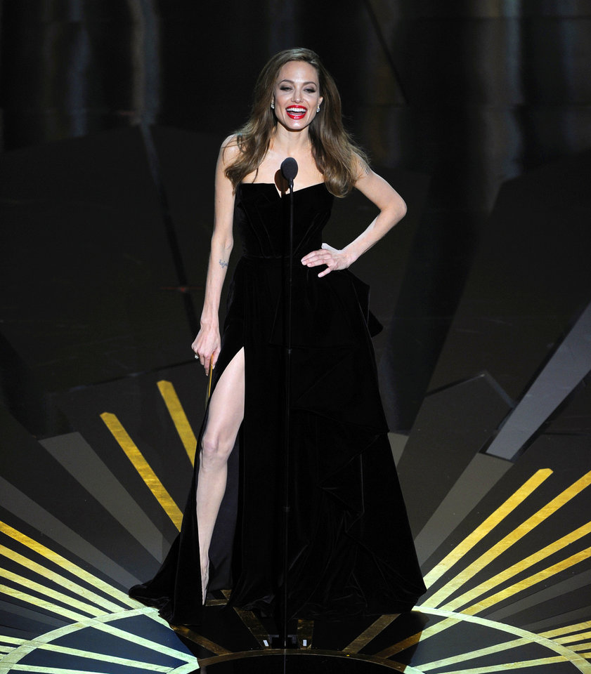 Angelina Jolie presents an award during the 84th Academy Awards on Sunday, Feb. 26, 2012, in the Hollywood section of Los Angeles. (AP Photo/Mark J. Terrill) ORG XMIT: SHO218
