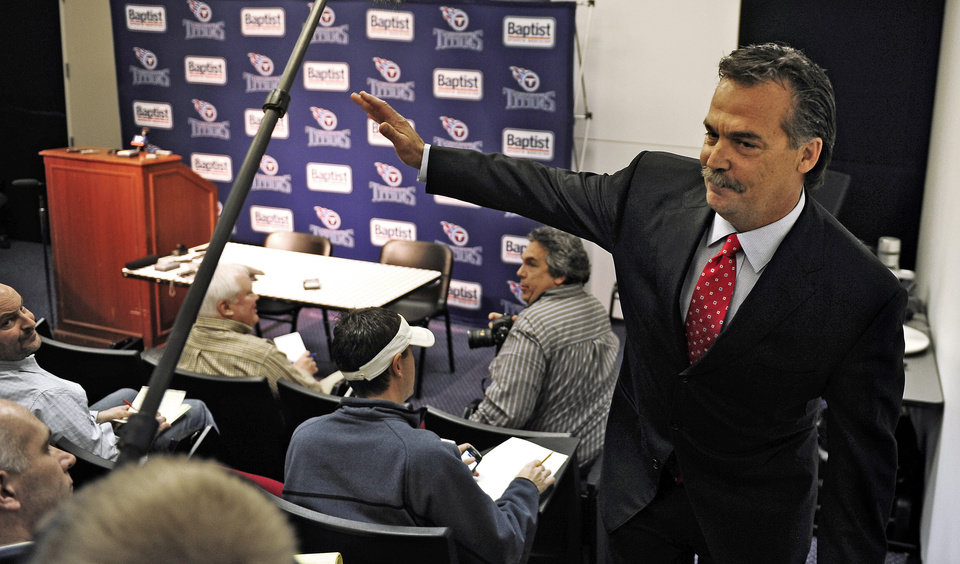 Photo -   Former Tennessee Titans head coach Jeff Fisher waves as he leaves an NFL football news conference at the team's headquarters on Friday, Jan. 28, 2011, in Nashville, Tenn. The Titans announced on Thursday that Fisher will not remain as head coach. (AP Photo/The Tennessean, George Walker IV)