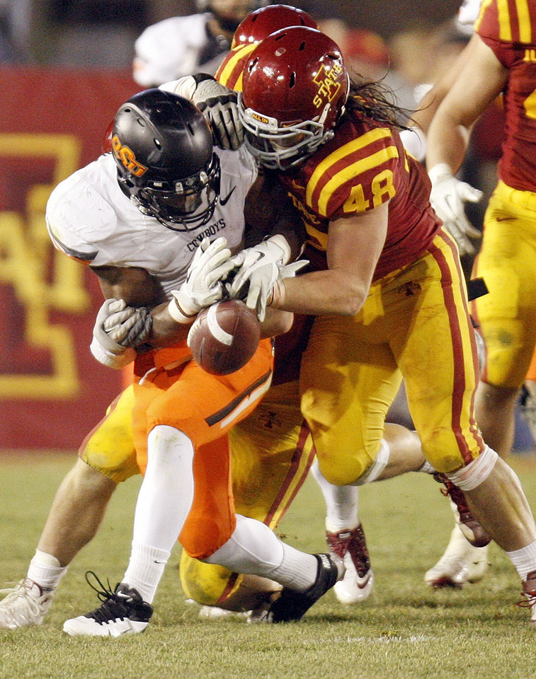Photo - ISU's Jake Lattimer (48) forces OSU's Joseph Randle (1) to fumble the ball in the third quarter during a college football game between the Oklahoma State University Cowboys (OSU) and the Iowa State University Cyclones (ISU) at Jack Trice Stadium in Ames, Iowa, Friday, Nov. 18, 2011. Iowa State won, 37-31, in double overtime. Photo by Nate Billings, The Oklahoman