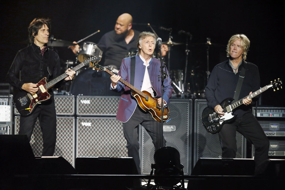 Photo - Paul McCartney performs with Rusty Anderson, left, Brian Ray, right, and drummer Abe Laboriel Jr. during his One On One tour stop at the Chesapeake Energy Arena in Oklahoma City, Monday, July 17, 2017. [Photo by Nate Billings, The Oklahoman]