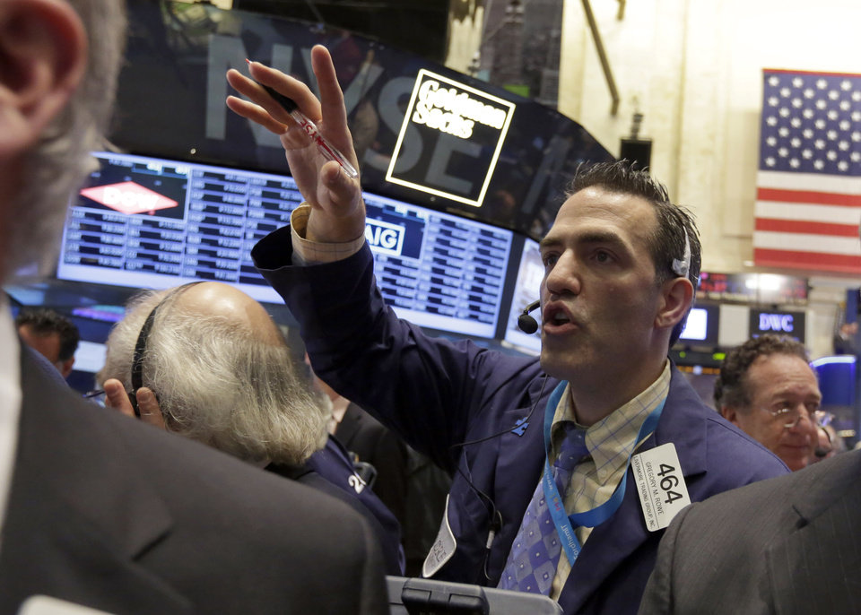 Photo - Trader Gregory Rowe works on the floor of the New York Stock Exchange, Friday, May 23, 2014. Stocks inched higher early Friday in quiet trading ahead of the Memorial Day weekend.  (AP Photo/Richard Drew)