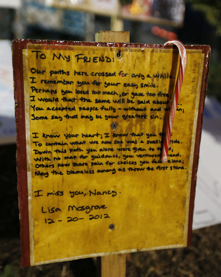 A letter intended for Nancy Lanza, one of the 27 people allegedly killed by Adam Lanza in the Sandy Hook village of Newtown, Conn., last week, is propped up on a wooden sign at a makeshift memorial, Thursday, Dec. 20, 2012. For the most part, makeshift memorials honor the 26 victims allegedly killed by the gunman, who forced himself into Sandy Hook Elementary School on Dec. 14, 2012. In total, 27 people were killed as officials say Lanza shot and killed his mother, Nancy Lanza, at their home. Nancy Lanza is virtually nonexistent in the memorials. (AP Photo/Julio Cortez)