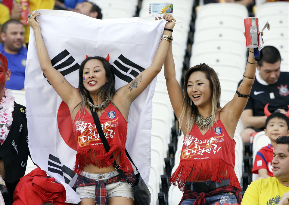 Photo - South Korea fans hold a flag as they cheer prior to the group H World Cup soccer match between South Korea and Belgium at the Itaquerao Stadium in Sao Paulo, Brazil, Thursday, June 26, 2014. (AP Photo/Lee Jin-man)