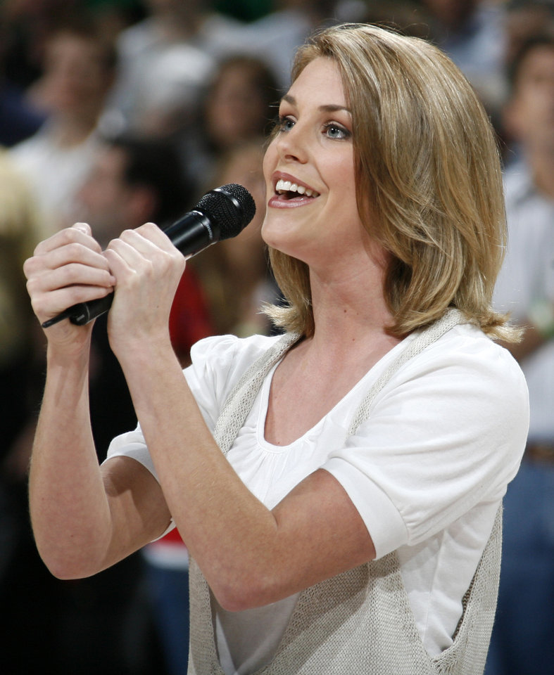Photo - Miss America 2007 Lauren Nelson sings the National Anthem before the NBA basketball game between the Oklahoma City Thunder and the Boston Celtics at the Ford Center in Oklahoma City, Wednesday, Nov. 5, 2008. BY NATE BILLINGS, THE OKLAHOMAN