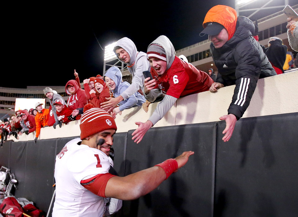 Photo - Oklahoma's Jalen Hurts (1) celebrates with fans following the Bedlam college football game between the Oklahoma State Cowboys (OSU) and Oklahoma Sooners (OU) at Boone Pickens Stadium in Stillwater, Okla., Saturday, Nov. 30, 2019. OU won  34-16. [Sarah Phipps/The Oklahoman]