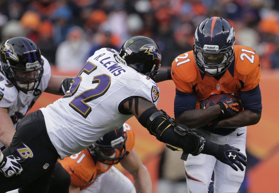 Photo - Denver Broncos running back Ronnie Hillman, right, is tackled by Baltimore Ravens inside linebacker Ray Lewis (52) in the second quarter of an AFC divisional playoff NFL football game, Saturday, Jan. 12, 2013, in Denver. (AP Photo/Charlie Riedel)