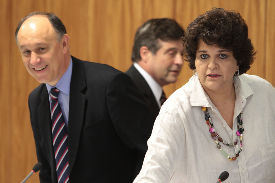 Photo -   Brazil's Environmental Minister Izabella Teixeira, right, and Agrarian Development Minister Pepe Vargas, left, arrive for a press conference at the Planalto presidential palace in Brasilia, Brazil, Friday, May 25, 2012. Agriculture Minister Mendes Ribeiro is behind center. Teixeira announced that President Dilma Rousseff used her line-item veto powers on a congressional bill that weakened the nation's benchmark environmental law protecting the Amazon. Environmentalists wanted Rousseff to veto the entire bill. (AP Photo/Eraldo Peres)