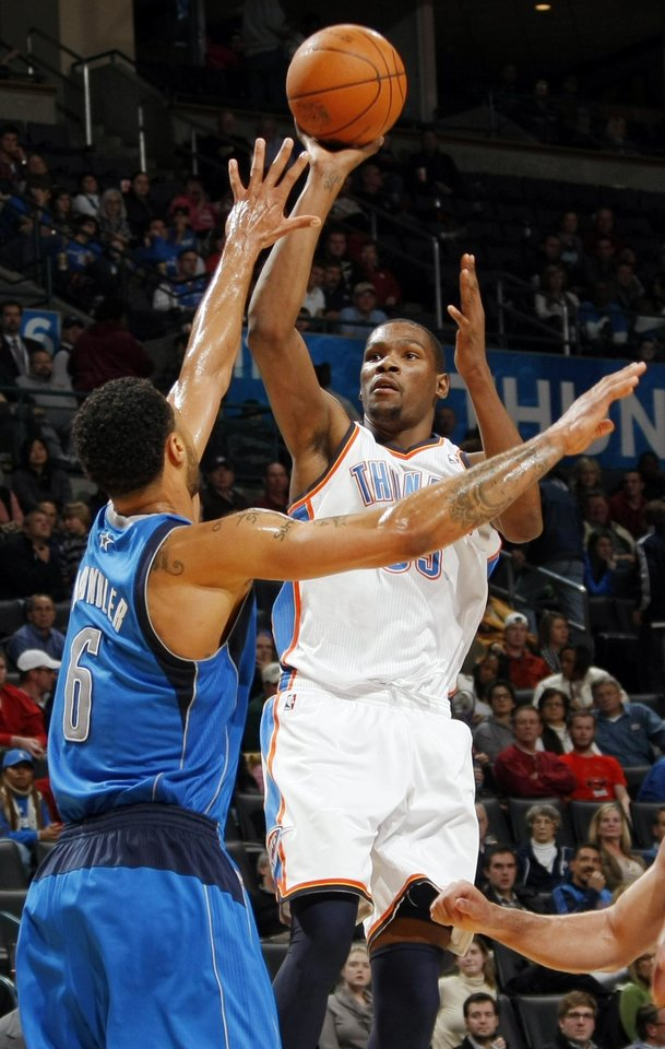 Photo - Oklahoma City's Kevin Durant (35) shoots over Tyson Chandler (6) of Dallas during the NBA basketball game between the Dallas Mavericks and the Oklahoma City Thunder at the Oklahoma City Arena in Oklahoma City, Monday, Dec. 27, 2010. Dallas won, 103-93. Photo by Nate Billings, The Oklahoman