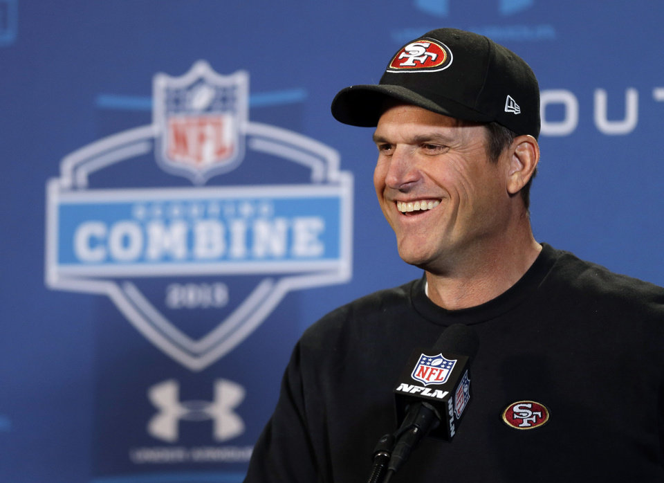 San Francisco 49ers head coach Jim Harbaugh answers a question during a news conference at the NFL football scouting combine in Indianapolis, Friday, Feb. 22, 2013. (AP Photo/Michael Conroy)