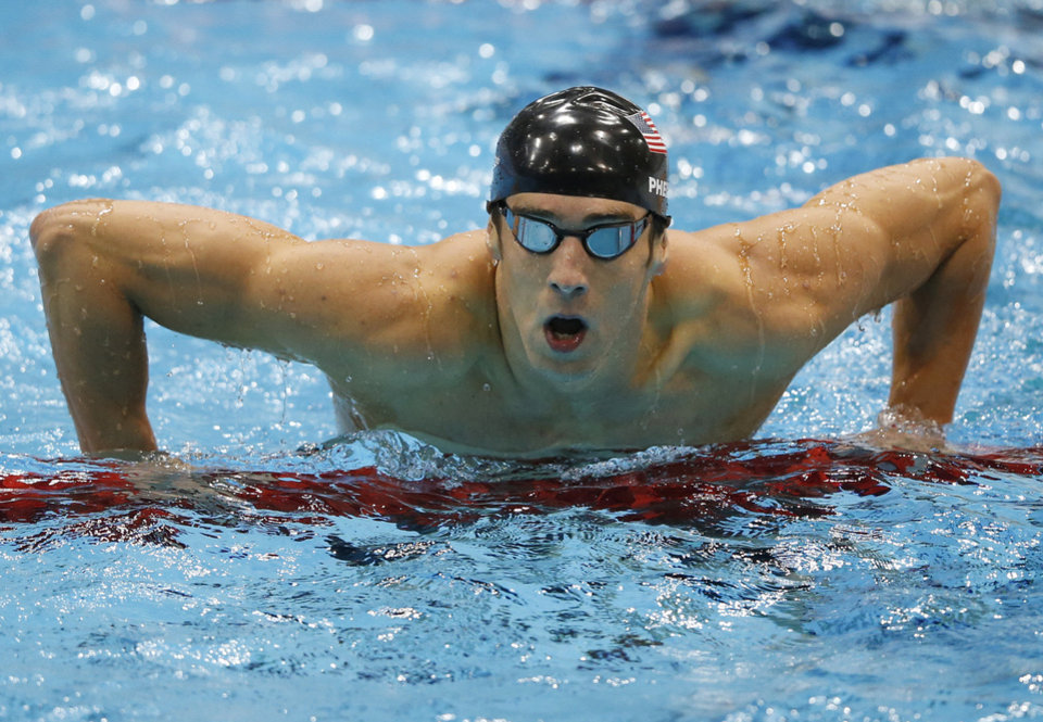 Photo - United States' Michael Phelps gets out of the water after swimming the butterfly in the men's 4 X 100-meter medley relay Saturday at the Aquatics Centre in Olympic Park during the 2012 Summer Olympics in London.  AP Photos