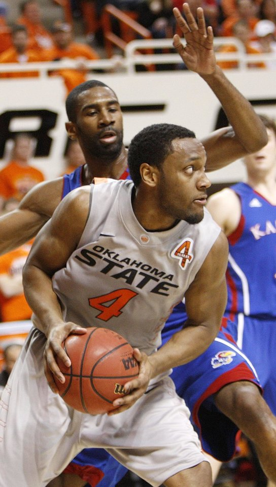 Photo - OSU's Brian Williams (4) works against KU's Justin Wesley (4) in the first half during a men's college basketball game between the Oklahoma State University Cowboys and the University of Kansas Jayhawks at Gallagher-Iba Arena in Stillwater, Okla., Monday, Feb. 27, 2012. Photo by Nate Billings, The Oklahoman