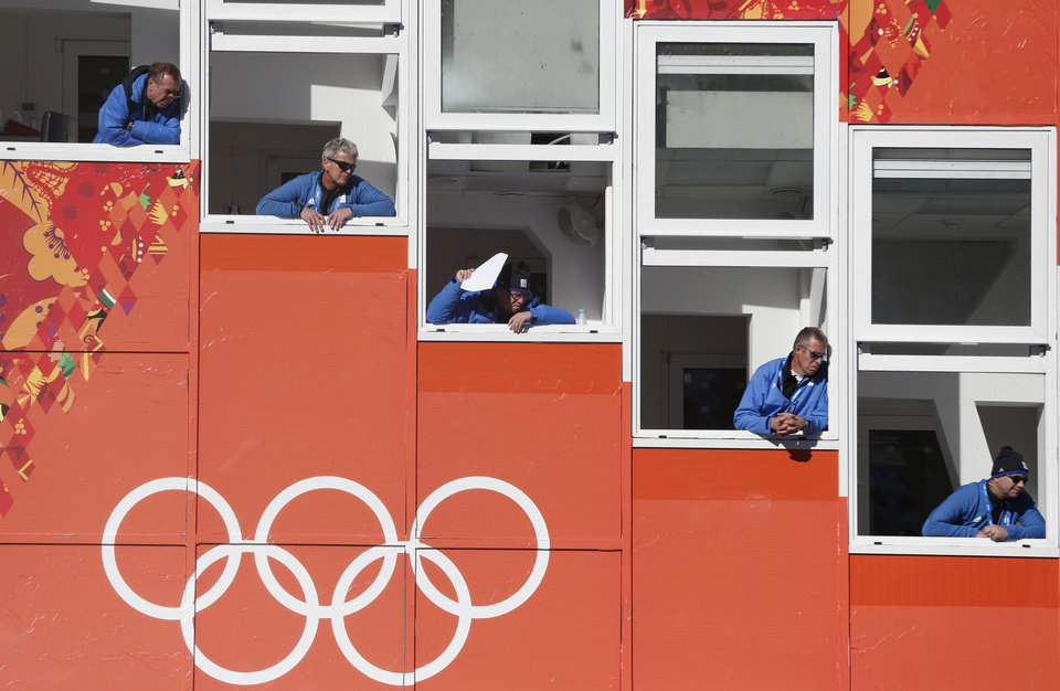 Photo - Judges watch an attempt during the men's normal hill ski jumping training at the 2014 Winter Olympics, Friday, Feb. 7, 2014, in Krasnaya Polyana, Russia. (AP Photo/Matthias Schrader)