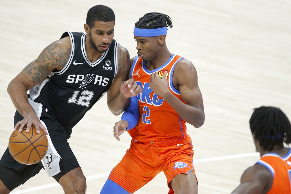 Photo - during an NBA basketball game between Oklahoma City's Shai Gilgeous-Alexander (2) defends San Antonio's LaMarcus Aldridge (12) the Oklahoma City Thunder and the San Antonio Spurs at Chesapeake Energy Arena in Oklahoma City, Tuesday, Jan. 12, 2021. [Bryan Terry/The Oklahoman]