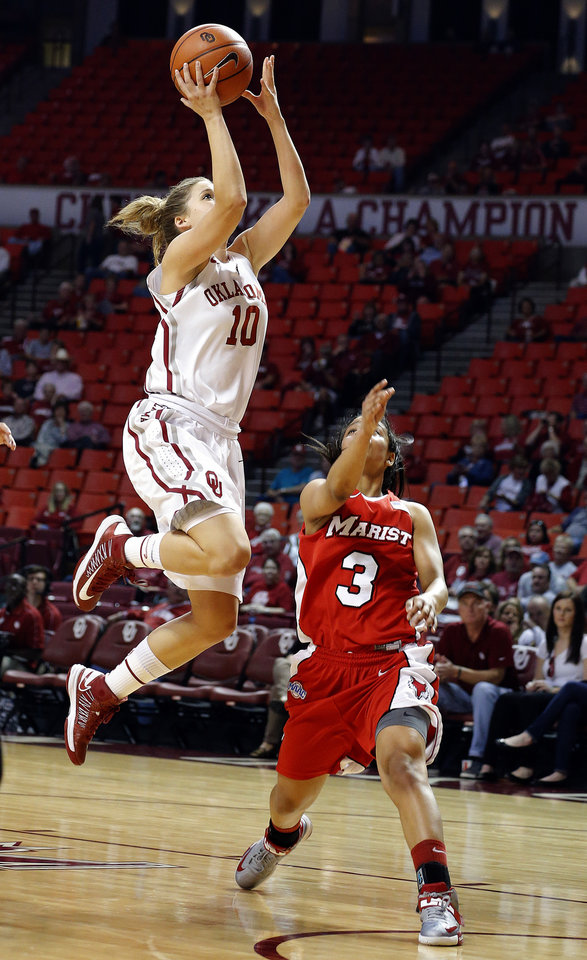Photo - Oklahoma's Morgan Hook (10) shoots in front of Marist's Natalie Gomez (3) during the women's college basketball game between the University of Oklahoma and Marist at Lloyd Noble Center in Norman, Okla.,  Sunday,Dec. 2, 2012. Photo by Sarah Phipps, The Oklahoman