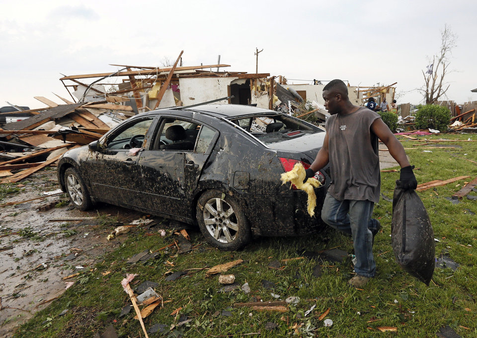 Babatunji Akande tries to salvage items from the debris of his friend's destroyed  home at SW 149th and Vicki after a tornado struck south Oklahoma City and Moore, Okla., Monday, May 20, 2013. Photo by Nate Billings, The Oklahoman